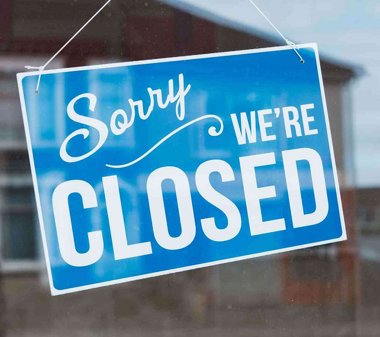 closed sign ing on a glass item