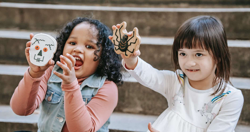 funny diverse kids with cookies