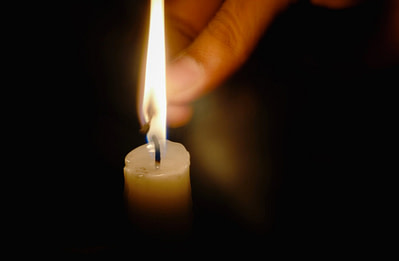 person lighting candle
