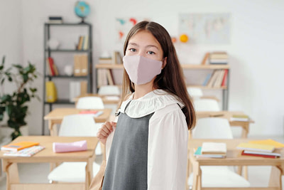 woman in white shirt wearing white face mask
