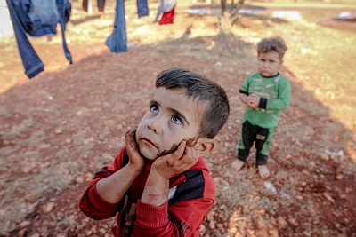 cute ethnic dirty boy in refugee camp
