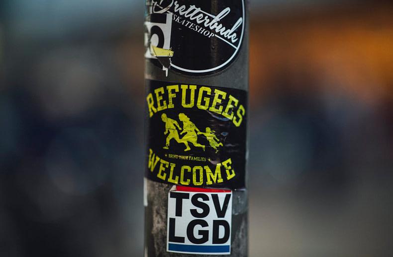 street metal pillar with various stickers